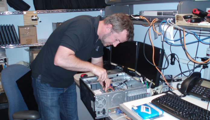 Grant Wright fixing computer