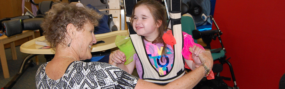 Smiling student at TBAISD center for students with cognitive impairments.